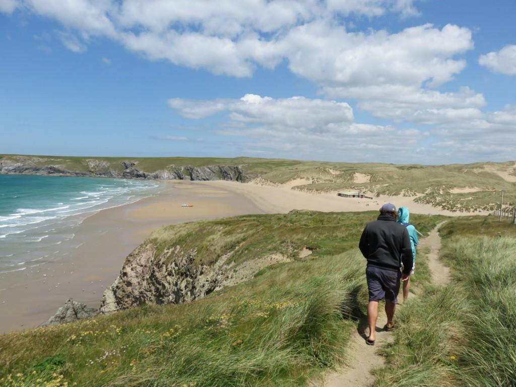 Coastal footpath walk Holywell Bay beach